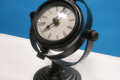 BLACK ROTATING CLOCK